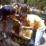 Chris and David drinking from a natural spring in Manitou
