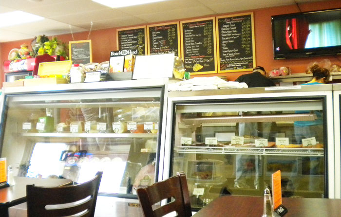 The deli case and menu board at Joanie's Deli in Woodland Park, Colorado.