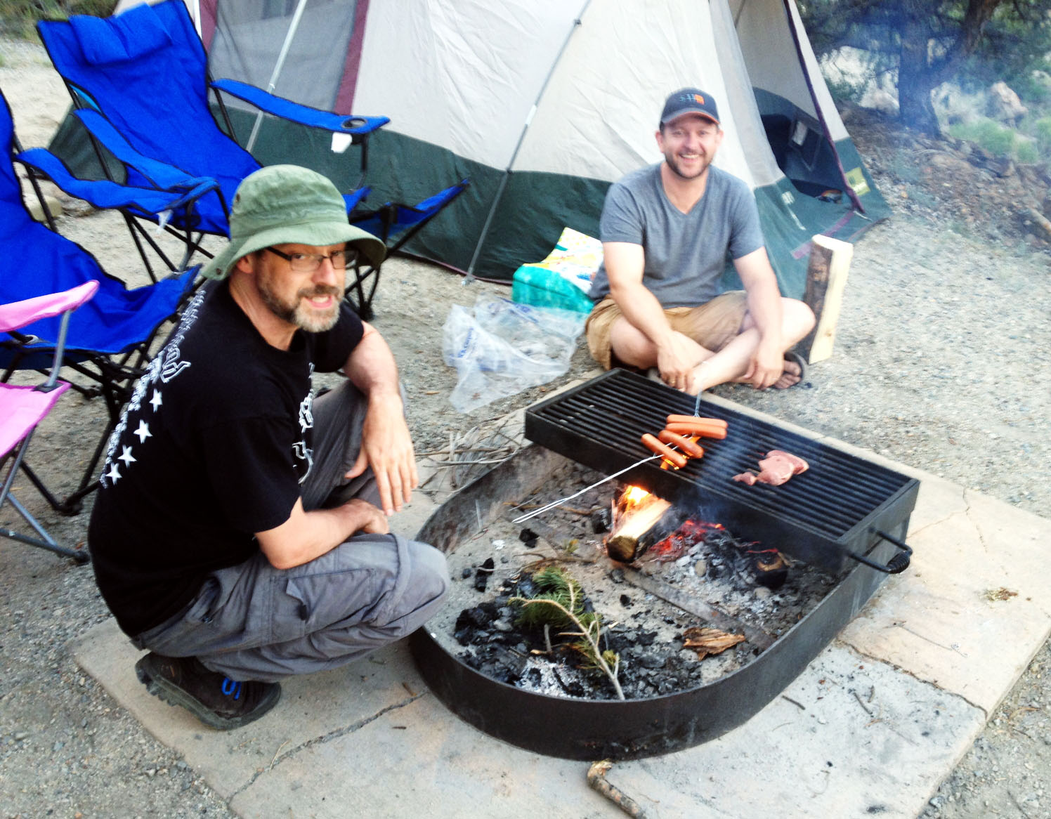 The guys finally gave up and used my fire for some tasty hot dogs.